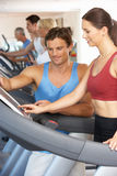 Woman Working With Personal Trainer Stock Images