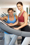 Woman Working With Personal Trainer Royalty Free Stock Images