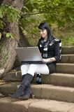 Woman working with portable laptop in the forest Stock Photo