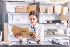 Woman working at the post office. Young woman working at the post office Royalty Free Stock Images
