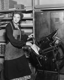 Woman working in print shop royalty free stock photos