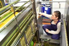 Woman working in printing industry Royalty Free Stock Photography