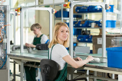 Woman working on production line Royalty Free Stock Images