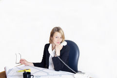 Woman working on a project. An architect woman working in her office Royalty Free Stock Photography
