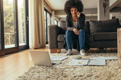 Woman working on a project from home Royalty Free Stock Images
