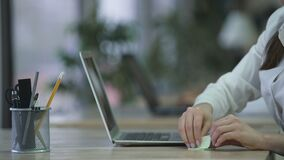 Woman working on project at office, writing ideas and notes on sticky paper. Stock footage stock footage