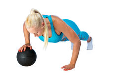 Woman working on push ups with ball Royalty Free Stock Photo