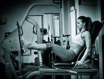 Woman working quads Stock Photo
