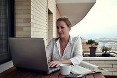 Woman working quietly on your terrace Royalty Free Stock Image