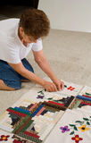 Woman working on quilt. Stock Images