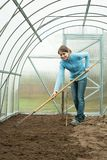 Woman working with rake Royalty Free Stock Photos