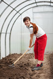 Woman working with rake Royalty Free Stock Photo