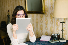 Woman working and reading at vintage home Stock Images