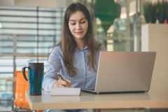 Woman working remotely at cafe royalty free stock images