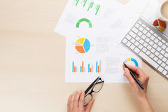 Woman working with reports and charts Royalty Free Stock Photo