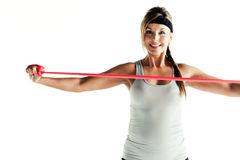 Woman working with a resistance band Royalty Free Stock Image