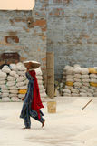 Woman working in a salt factory Stock Photography