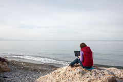 Woman working at the seaside Stock Photos