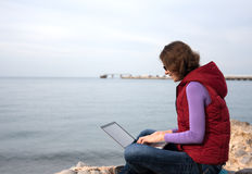 Woman working at the seaside Royalty Free Stock Photos