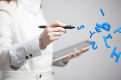 Woman working with a set of letters, writing concept. Royalty Free Stock Photography