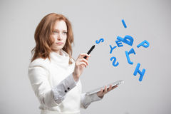 Woman working with a set of letters, writing concept. Stock Image