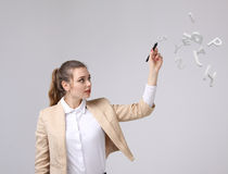 Woman working with a set of letters, writing concept. Stock Photos