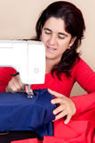 Woman working on a sewing machine Stock Photography