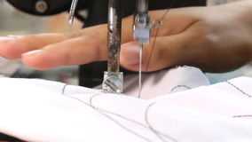 Woman working with sewing machine. stock video footage