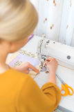 Woman working on sewing machine. Royalty Free Stock Images