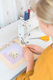 Woman working on sewing machine. Royalty Free Stock Photos