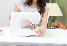 Woman working with sewing machine Royalty Free Stock Image