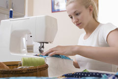 Woman Working With Sewing Machine At Home Stock Image
