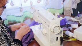 Woman working on a sewing machine. stock footage