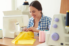 Woman working on sewing machine Stock Image