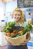 Woman Working In Shop With Basket Of Fresh Produce Royalty Free Stock Images