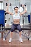 Woman working shoulders with dumbbells Royalty Free Stock Photo