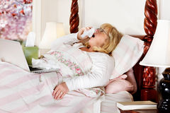 Woman working & sick Stock Photography