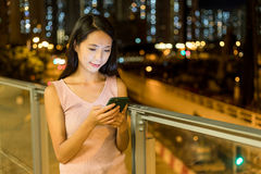 Woman working on smart phone. Asian young woman Royalty Free Stock Image