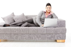 Woman working on sofa Royalty Free Stock Image
