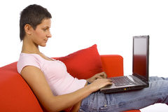 Woman working on the sofa Stock Photo