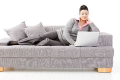 Woman working on sofa Royalty Free Stock Photography