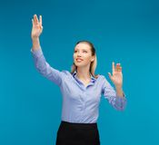 Woman working with something imaginary Stock Photos