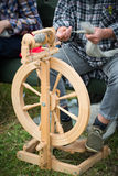 Woman working with spinning wheel Royalty Free Stock Photos