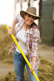 Woman working stable. Pretty young woman working in stable Stock Photography