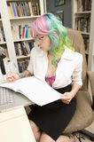 Woman working in study room Royalty Free Stock Images
