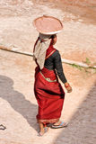 Woman working at sunset, Agra. Royalty Free Stock Images