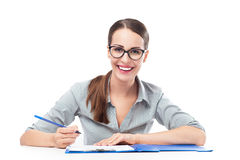 Woman working at table Stock Photos