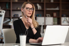 The woman working at the table. Royalty Free Stock Photo