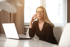 The woman working at the table. Stock Photos