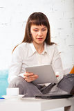Woman working on a tablet computer Stock Image